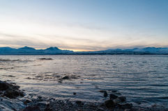 Coast of Tromso city in Tromsoya Island under the Midnight Sun i Royalty Free Stock Image