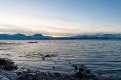 Coast of Tromso city in Tromsoya Island under the Midnight Sun i Royalty Free Stock Image