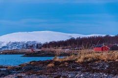 Coast of Tromso city in Tromsoya Island under the Midnight Sun i Stock Image