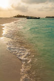 Coast of a tropical island with sand at sunset, Maldives Royalty Free Stock Photo