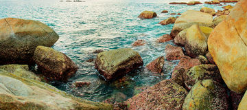 Coast of tropical sea with big stones. Thailand, Phuket island Royalty Free Stock Photos