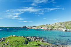 Coast turquoise water hebrides Scotland. Beach at Fionnphort, Mull with turquoise sea water and blue sky, hebrides, Scotland, copy space Stock Photo