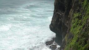 Awesome power of giant waves breaking over rocks in Uluwatu Bali. Coast at Uluwatu temple aerial view, Bali, Indonesia stock video