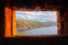 Coast view inside of window frame of fortress Royalty Free Stock Image
