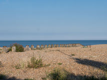 At the coast. A view of a coast and the sea extending to the horizon royalty free stock photo