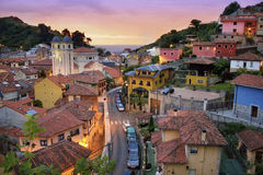 Coast village at Sunset in Asturias, Spain. Little village of Asturias, Spain, next to the sea. This photography show the sunset in this beautiful landscape stock photos