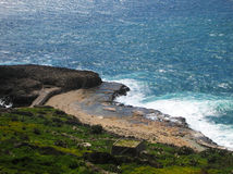 Coast and waves. Italian coast with waves and blue sea Royalty Free Stock Photo