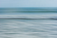 Coastal abstract motion blurred ocean waves blue tones backgroun Royalty Free Stock Photography