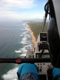 Coastal adventure. Aerial view of a coastline taken from the open air cockpit of a microlight, cockpit visible Royalty Free Stock Image