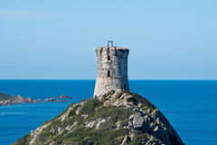 Coastal ancient tower on the little mount stock image