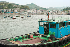Coastal area with fishing boats at Lamma Island, Hong Kong. LAMMA ISLAND is situated only 3km off the south west coast of Hong Kong Island from which it is Royalty Free Stock Photography