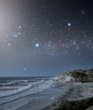 Coastal area with a star-filled sky Stock Photo