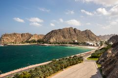 Coastal avenue in Muscat, Oman. With road following the sea and going into a valley on the right side Royalty Free Stock Photography