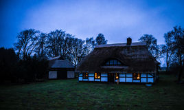 Coastal beach house with thatched roof Royalty Free Stock Photos