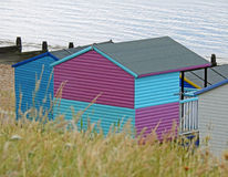 Coastal beach huts. Photo of kent coastal beach huts with wild grass in foreground july 2017 Royalty Free Stock Images