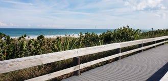 Coastal Boardwalk. View of ocean past the dunes stock photography