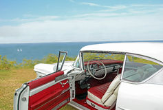 Coastal cadillac. Photo of a vintage classic cadillac parked at coast with view inside car stock photo