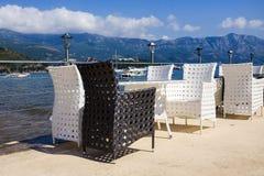 Coastal cafe tables on the sea Royalty Free Stock Photo