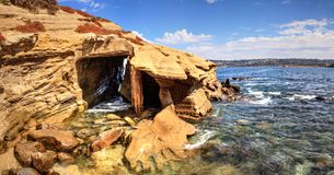 Coastal caves at La Jolla Cove. In Southern California in summer on a sunny day Stock Photos