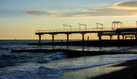 A coastal city dock. At the beach at sunset stock photography