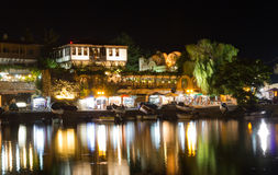 Coastal city illuminated at night in summer Royalty Free Stock Images