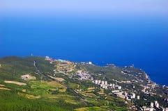 Coastal city view from bird flight. View of the coastal city from bird flight, Yalta, Ukraine, Crimea Royalty Free Stock Photo