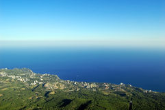 Coastal city view from bird flight. View of the coastal city from bird flight, Yalta, Ukraine, Crimea Royalty Free Stock Photography