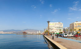 Coastal cityscape with walking people, Izmir Royalty Free Stock Image