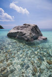 Coastal clear waters and rocky area Stock Images