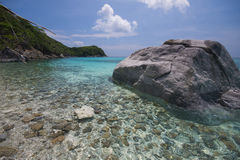 Coastal clear waters and rocky area Stock Photos