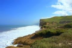 Coastal cliff. Coastal beach view with waves Royalty Free Stock Photos
