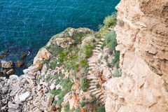 Coastal cliff with stone stairway. Bulgaria Stock Images