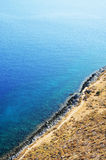 Coastal cliffs and blue waters Stock Images