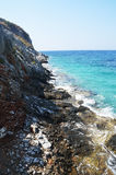 Coastal cliffs and blue waters Stock Photo