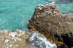Coastal cliffs and blue waters Royalty Free Stock Image
