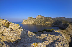 Coastal cliffs in the early quiet morning. Stock Photos