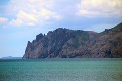Coastal cliffs. An extinct volcano Karadag near the village Stock Photos