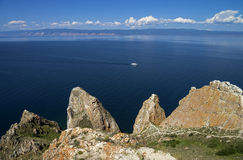 Coastal cliffs of the island Olkhon. Lake Baikal, Russia. Stock Photos