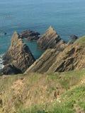 Coastal Cliffs. Jagged rocks below coastal cliffs royalty free stock images