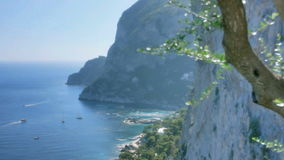Coastal Cliffs of Monte Castiglione Capri Italy. Medium long high angle high dynamic range shallow depth of field panning tracking slider shot of the coastal stock footage