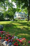 Coastal Cottage with flowers, Bar Harbor, Maine. Charming Northeastern cottage near Bar Harbor, Maine with flowers blooming in front royalty free stock photography