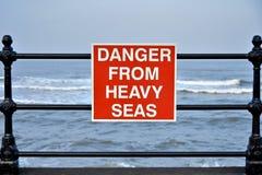 Coastal danger sign Stock Images