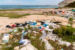 Coastal degradation with dirty beach, rubbish and domestic waste polluting the Capaci beach in province of Palermo. Coastal degradation with dirty beach royalty free stock photography