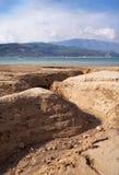 Coastal earth erosion. View of a small ravine - the result of coastal erosion Royalty Free Stock Photos