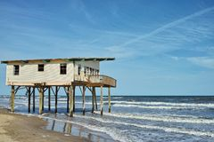 Coastal Erosion. A picture which vividly depicts the challenge of coastal erosion - this abandoned house now sits in the waters of the Gulf of Mexico Royalty Free Stock Photography