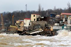 Coastal erosion - houses built on weak clay soil slide down to the sea and collapse. In Odessa, Ukraine Stock Photos
