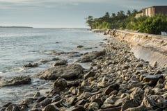 Coastal erosion, climate change. Coastal low lying island communities are facing challenges by coastal erosion Stock Image