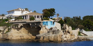 Coastal erosion. A partially collapsed house due to coastal erosion Stock Image