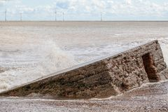 Coastal erosion and rising sea level reclaiming a WW2 beach defe Stock Photography