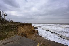 Coastal erosion taking place during a winter storm. UK, HAPPISBURGH - 18 MAR 2018: Coastal erosion taking place during a winter storm. Many homes have recently Stock Photography